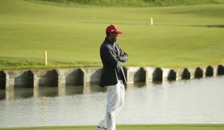 Tiger Woods of the US attends the closing ceremony after Europe won the Ryder Cup on the final day of the 42nd Ryder Cup at Le Golf National in Saint-Quentin-en-Yvelines, outside Paris, France, Sunday, Sept. 30, 2018. (AP Photo/Matt Dunham)