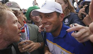 Europe's Francesco Molinari celebrates after winning his singles match to clinch the Ryder Cup for Europe on the final day of the 42nd Ryder Cup at Le Golf National in Saint-Quentin-en-Yvelines, outside Paris, France, Sunday, Sept. 30, 2018. (AP Photo/Laurent Cipriani)