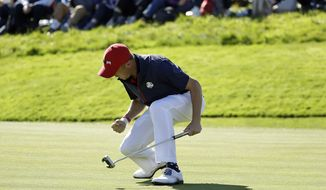 Justin Thomas of the US celebrates after winning the 8th hole during a singles match on the final day of the 42nd Ryder Cup at Le Golf National in Saint-Quentin-en-Yvelines, outside Paris, France, Sunday, Sept. 30, 2018. (AP Photo/Matt Dunham)