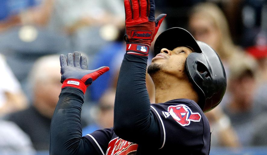 Cleveland Indians' Francisco Lindor celebrates as he crosses the plate after hitting a solo home run during the third inning of a baseball game against the Kansas City Royals Sunday, Sept. 30, 2018, in Kansas City, Mo. (AP Photo/Charlie Riedel)