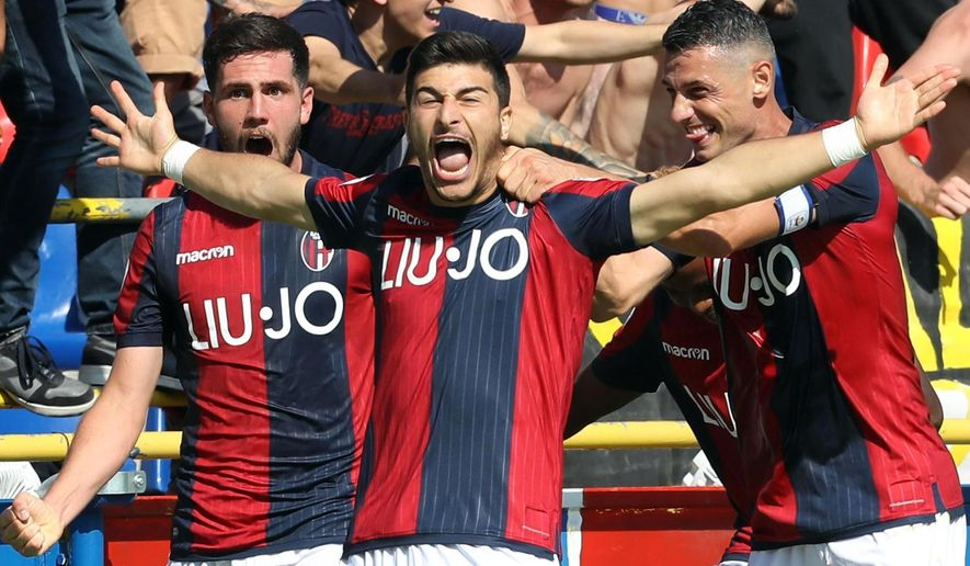 "Bologna's Riccardo Orsolini, center, celebrates with teammates after scoring his side's second goal during a serie A soccer match between Bologna and Udinese at the ""Dall'Ara"" stadium in Bologna, Italy, Sunday, Sept. 30, 2018. (Giorgio Benvenuti/ANSA via AP)"