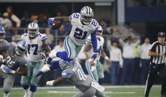 Dallas Cowboys running back Ezekiel Elliott (21) leaps over Detroit Lions defensive back Tracy Walker (47) in the second half of an NFL football game in Arlington, Texas, Sunday, Sept. 30, 2018. (AP Photo/Ron Jenkins)