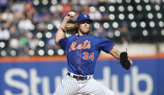 New York Mets' Noah Syndergaard delivers a pitch during the first inning of a baseball game against the Miami Marlins, Sunday, Sept. 30, 2018, in New York. (AP Photo/Jason DeCrow)