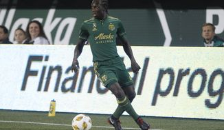 Portland Timbers' Diego Chara (21) works with the ball against FC Dallas during an MLS soccer match Saturday, Sept. 29, 2019, in Portland, Ore. (Sean Meagher/The Oregonian via AP)