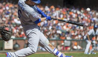 Los Angeles Dodgers Brian Dozier hits a two-run homer against the San Francisco Giants in the third inning of a baseball game in San Francisco, Sunday, Sept. 30, 2018. (AP Photo/John Hefti)