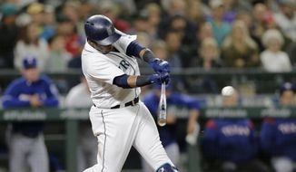 Seattle Mariners' Jean Segura hits an RBI single against the Texas Rangers during the seventh inning of a baseball game, Saturday, Sept. 29, 2018, in Seattle. (AP Photo/John Froschauer) **FILE**