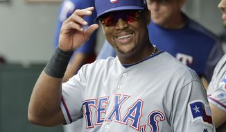Texas Rangers' Adrian Beltre smiles in the dugout during the fifth inning of a baseball game against the Seattle Mariners after he was replaced by Jurickson Profar at third base, Sunday, Sept. 30, 2018, in Seattle. (AP Photo/Ted S. Warren)