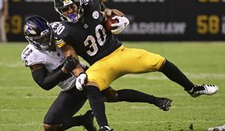 Pittsburgh Steelers running back James Conner (30) is tackled by Baltimore Ravens defensive back Tony Jefferson (23) during the first half of an NFL football game in Pittsburgh, Sunday, Sept. 30, 2018. (AP Photo/Fred Vuich)
