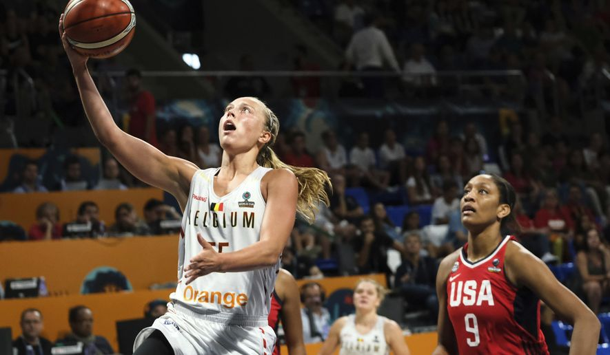 Julie Allemand of the Belgian jumps to basket against A'Ja Wilson of the United States during the Women's basketball World Cup semi final match between Belgium and the U.S.A. in Tenerife, Spain, Saturday Sept. 29, 2018. (AP Photo Andres Gutierrez)