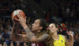 Brittney Griner of the United States, left, jumps to shoot as Steph Talbot of Australia tries to stop her during the Women's basketball World Cup final match between Australia and the U.S.A. in Tenerife, Spain, Sunday Sept. 30, 2018. (AP Photo/Andres Gutierrez)