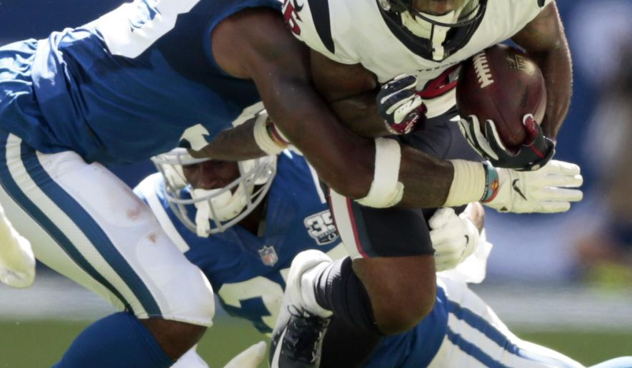 Houston Texans wide receiver Keke Coutee (16) is tackled by Indianapolis Colts' Darius Leonard during the first half of an NFL football game, Sunday, Sept. 30, 2018, in Indianapolis. (AP Photo/AJ Mast)