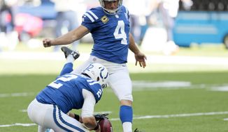 Indianapolis Colts kicker Adam Vinatieri (4) kicks a 42-yard field goal out of the hold of Rigoberto Sanchez during the first half of an NFL football game against the Houston Texans, Sunday, Sept. 30, 2018, in Indianapolis. Vinatieri passed Morten Andersen for the most career field goals made in NFL history with the field goal. (AP Photo/AJ Mast)