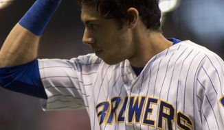 Milwaukee Brewers center fielder Christian Yelich tips his cap as he is pulled from the game against the Detroit Tigers during the eight inning of an baseball game Sunday, Sept. 30, 2018, in Milwaukee. (AP Photo/Darren Hauck)
