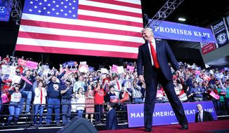 President Trump takes the stage during a campaign rally on Saturday in Wheeling, West Virginia. Four more rallies will follow this week. (Associated Press)