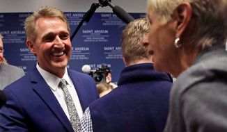 U.S. Sen. Jeff Flake, R-Arizona, shakes hands with a guest following an address in Manchester, N.H., Monday, Oct. 1, 2018. Flake, days after a critical vote in support of Supreme Court nominee Brett Kavanaugh, made his second visit this year to New Hampshire. The visit will once again stoke suggestions that he might run against President Trump in 2020. (AP Photo/Charles Krupa) (Associated Press)