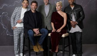 """In this Sept. 9, 2018 photo, Bradley Cooper, seated left, cast member and director of the film """"A Star is Born,"""" poses with actors, from left, Anthony Ramos, Sam Elliott, Lady Gaga and Dave Chappelle at the Four Seasons Hotel during the Toronto International Film Festival in Toronto. The film opens in theaters on Friday, Oct. 5. (Photo by Chris Pizzello/Invision/AP)"""