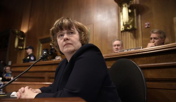 In this Thursday, Sept. 27, 2018, photo, Rachel Mitchell, a prosecutor from Arizona, waits for Christine Blasey Ford, the woman accusing Supreme Court nominee Brett Kavanaugh of sexually assaulting her, to testify before the U.S. Senate Judiciary Committee on Capitol Hill in Washington. (Saul Loeb/Pool Photo via AP)