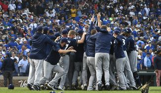 Milwaukee Brewers players celebrate after defeating the Chicago Cubs 3-1 at the end of a tiebreak baseball game on Monday, Oct. 1, 2018, in Chicago. (AP Photo/Matt Marton)