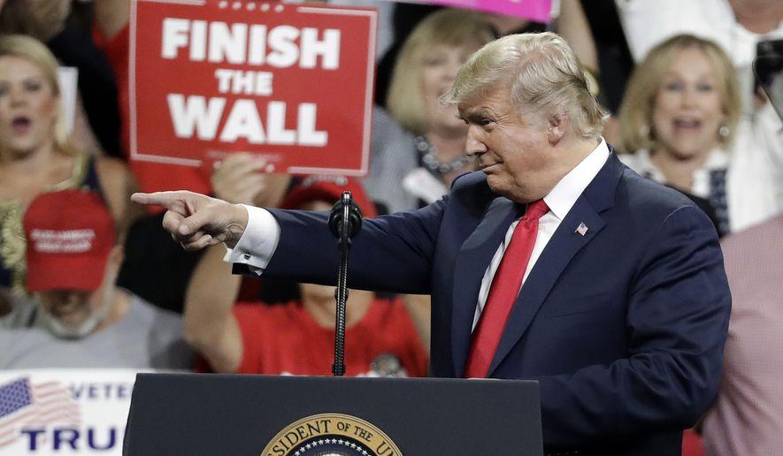 President Donald Trump speaks at a rally Monday, Oct. 1, 2018, in Johnson City, Tenn. (AP Photo/Mark Humphrey)