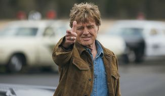 """Actor Robert Redford performs in a scene from the film, """"The Old Man & The Gun."""" Redford stars as an aged bank robber in David Lowery's film based-on-a-true-story heist. (Eric Zachanowich/Fox Searchlight via AP)  ** FILE **"""