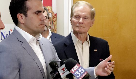 Puerto Rico Governor Ricardo Rossello, left, endorses U.S. Sen. Bill Nelson for the senate during a news conference Monday Oct. 1, 2018, in Orlando, Fla. (AP Photo/John Raoux)