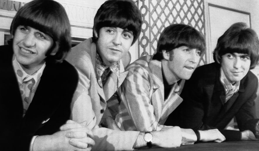 """FILE - In this Aug. 23, 1966 file photo, The Beatles, from left, Ringo Starr; Paul McCartney; John Lennon; and George Harrison appear at a press conference in New York. Giles Martin says his father, producer George Martin, would wince whenever a fan would say that the """"White Album"""" was their favorite Beatles' record. The late George Martin would recall how tough it was to make the sprawling double album, titled """"The Beatles"""" but given its familiar nickname because of the all-white cover. His son is in charge of a 50th anniversary repackaging that is due out Nov. 9. (AP Photo, File)"""