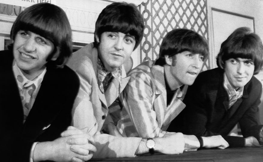 "FILE - In this Aug. 23, 1966 file photo, The Beatles, from left, Ringo Starr; Paul McCartney; John Lennon; and George Harrison appear at a press conference in New York. Giles Martin says his father, producer George Martin, would wince whenever a fan would say that the ""White Album"" was their favorite Beatles' record. The late George Martin would recall how tough it was to make the sprawling double album, titled ""The Beatles"" but given its familiar nickname because of the all-white cover. His son is in charge of a 50th anniversary repackaging that is due out Nov. 9. (AP Photo, File)"