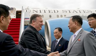 In this July 6, 2018, file photo, U.S. Secretary of State Mike Pompeo, second from left, is greeted by North Korean Director of the United Front Department Kim Yong-chol, center, and North Korean Foreign Minister Ri Yong-ho, second from right, as he arrives at Sunan International Airport in Pyongyang, North Korea. North Korea warned Washington through its state media Tuesday, Oct. 2, that a declaration ending the Korean War shouldn't be seen as a bargaining chip in denuclearization talks  but suggested lifting sanctions might be. (AP Photo/Andrew Harnik, Pool, File)