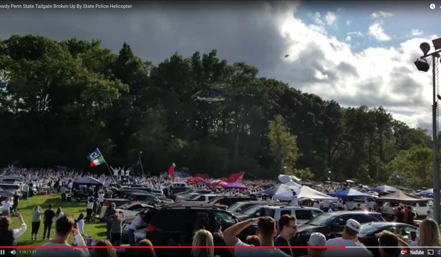 """""""The helicopter made an initial pass at a higher altitude, but (the) loudspeaker could not be ... heard,"""" Tarkowski said. """"The second pass was lower to ensure people on the ground could hear the order to disperse."""" (Screen grab from youtube video posted by B Mack)"""