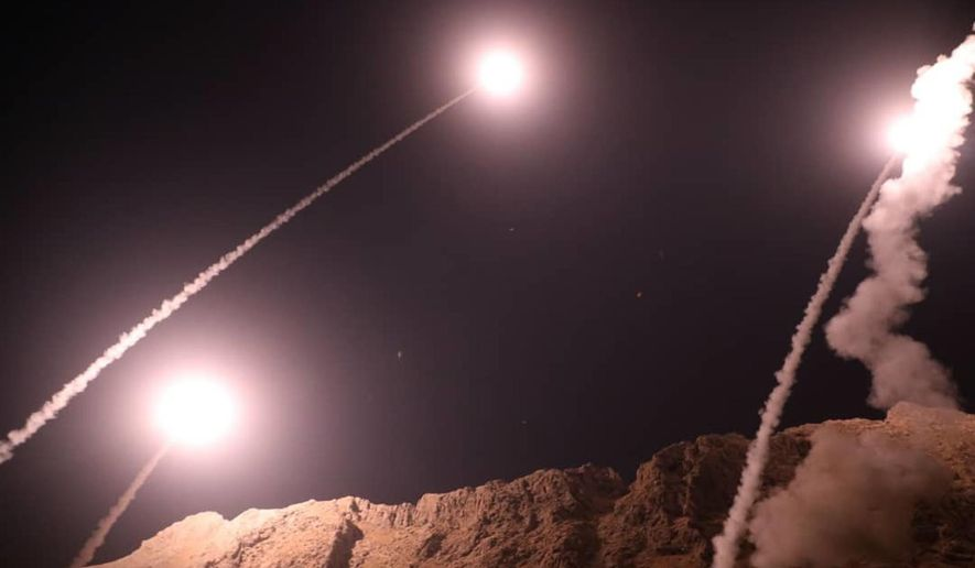 In this photo released on Monday, Oct. 1, 2018, by the Iranian Revolutionary Guard, missiles are fired from city of Kermanshah in western Iran targeting the Islamic State group in Syria. Iran's paramilitary Revolutionary Guard said Monday it launched ballistic missiles into eastern Syria targeting militants it blamed for a recent attack on a military parade. (Sepahnews via AP)
