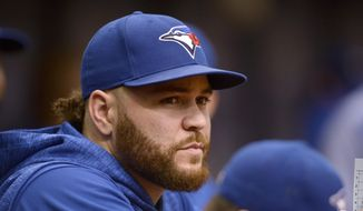 Toronto Blue Jays Russell Martin (55) steps in as the team's manager during the first inning of a baseball game against the Tampa Bay Rays Sunday, Sept. 30, 2018, in St. Petersburg, Fla. (AP Photo/Jason Behnken)