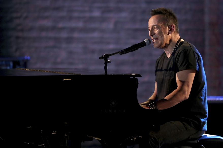 """FILE - In this June 10, 2018, file photo, Bruce Springsteen performs at the 72nd annual Tony Awards at Radio City Music Hall in New York. """"The Boss"""" took a break from """"Springsteen on Broadway"""" and performed with the band Social Distortion at the inaugural Sea.Hear.Now festival in Asbury Park, N.J., on Sunday, Sept. 30. (Photo by Michael Zorn/Invision/AP, File)"""