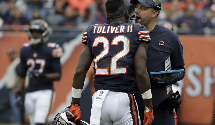 Chicago Bears head coach Matt Nagy talks to defensive back Kevin Toliver (22) during the first half of an NFL football game against the Tampa Bay Buccaneers Sunday, Sept. 30, 2018, in Chicago. (AP Photo/Nam Y. Huh)