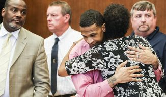 Quinton Tellis and defense attorney Darla Palmer hug after the judge declared a mistrial during the seventh day of Tellis' retrial of Monday, Oct. 1, 2018, in Batesville, Miss. The jury could not reach a unanimous decision which resulted in a mistrial.(Brad Vest/The Commercial Appeal via AP)