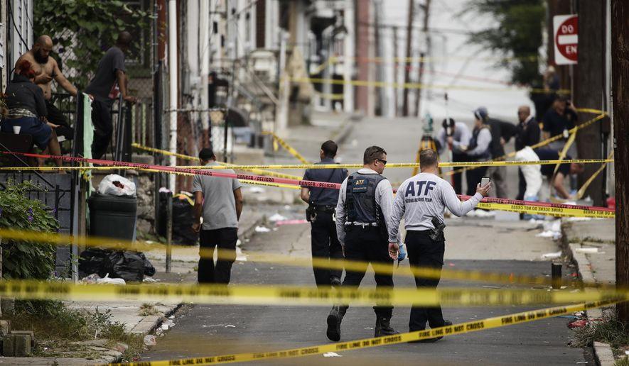 Authorities investigate the scene of Saturday's fatal car explosion in Allentown, Pa., Monday, Oct. 1, 2018. (AP Photo/Matt Rourke)