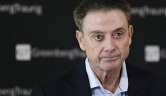 FILE- In this Feb. 21, 2018 file photo, former Louisville basketball Hall of Fame coach Rick Pitino talks to reporters during a news conference in New York. A recruiter, a coach and a former Adidas executive are scheduled to go on trial in New York in a criminal case that exposed corruption in several top U.S. college basketball programs. It also led to the firing of Pitino and sidelined the playing career of standout recruit Brian Bowen Jr. (AP Photo/Seth Wenig, File) **FILE**