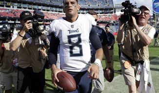 Tennessee Titans quarterback Marcus Mariota leaves the field after the Titans beat the Philadelphia Eagles in overtime of an NFL football game Sunday, Sept. 30, 2018, in Nashville, Tenn. The Titans won 26-23. (AP Photo/James Kenney)