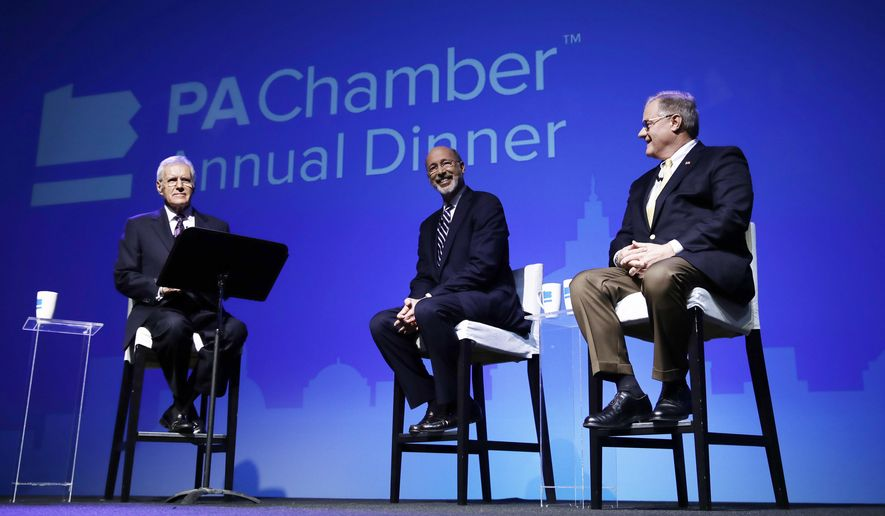 Alex Trebek, left, moderators a gubernatorial debate between Democratic Gov. Tom Wolf, center, and Republican Scott Wagner in Hershey, Pa., Monday, Oct. 1, 2018. The debate is hosted by the Pennsylvania Chamber of Business and Industry. (AP Photo/Matt Rourke)