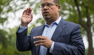 FILE - In this Aug. 17, 2017, file photo, U.S. Rep. Keith Ellison addresses campaign volunteers and supporters in Minneapolis. A lawyer investigating a claim by Ellison's ex-girlfriend, Karen Monahan that she was physically abused by Ellison in 2016 has concluded the allegation is unsubstantiated. The Associated Press on Monday, Oct. 1, 2018, obtained a draft of the report by Susan Ellingstad, an attorney hired by Minnesota's Democratic-Farmer-Labor Party to investigate the allegation. (Alex Kormann /Star Tribune via AP, File)