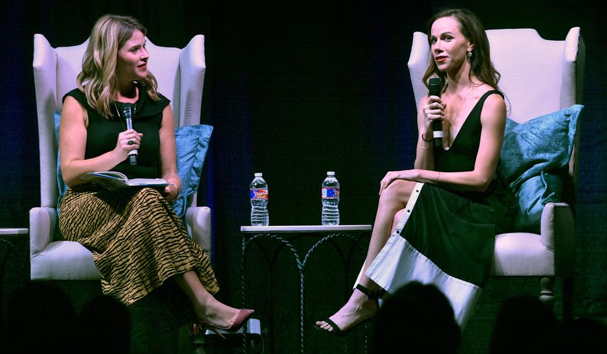 In this Wednesday Sept. 26, 2018 photo, sisters Jenna Bush Hager, left,  and Barbara Pierce Bush talk about their famous parents and grandparents at the Abilene Convention Center, in Abilene, Texas. The women are the daughters of former President George W. Bush, and the granddaughters of former President George H.W. Bush. They spoke during the Sisters First Dinner, an event for the Texas Tech University Health Sciences Center Laura W. Bush Institute for Women's Health. (Ronald W. Erdrich/The Abilene Reporter-News via AP)
