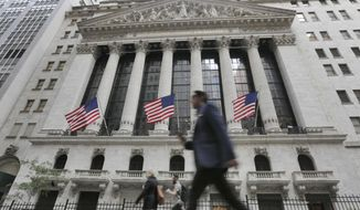 FILE - In this June 24, 2016, file photo, people walk by the New York Stock Exchange. On Monday, Oct. 1, 2018, stocks are opening broadly higher on Wall Street, led by big gains in industrials after General Electric named a new CEO. (AP Photo/Richard Drew, File)