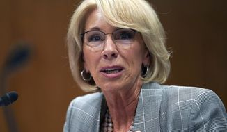 In this June 5, 2018, file photo, Education Secretary Betsy DeVos testifies during hearing on the FY19 budget on Capitol Hill in Washington. A little-known venture capitalist is on the verge of acquiring one of the country's biggest for-profit colleges, a transaction that would put him in control of a troubled national chain vastly larger than the tiny California school he currently owns. (AP Photo/Carolyn Kaster, File)