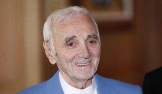 In this June 6, 2015, file photo, French and Armenian singer, songwriter and actor, Charles Aznavour poses in Cannes, southeastern France. Charles Aznavour, the French crooner and actor whose performing career spanned eight decades, has died. He was 94. (AP Photo/Lionel Cironneau, File)