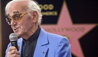 FILE - In this Aug.24, 2017 file photo, singer and songwriter Charles Aznavour appears at a ceremony honoring him with a star on the Hollywood Walk of Fame in Los Angeles. Charles Aznavour, the French crooner and actor whose performing career spanned eight decades, has died. He was 94. (AP Photo/Damian Dovarganes, File)