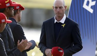 US team captain Jim Furyk attends the trophy ceremony after the European team won the 2018 Ryder Cup golf tournament at Le Golf National in Saint Quentin-en-Yvelines, outside Paris, France, Sunday, Sept. 30, 2018. (AP Photo/Alastair Grant)
