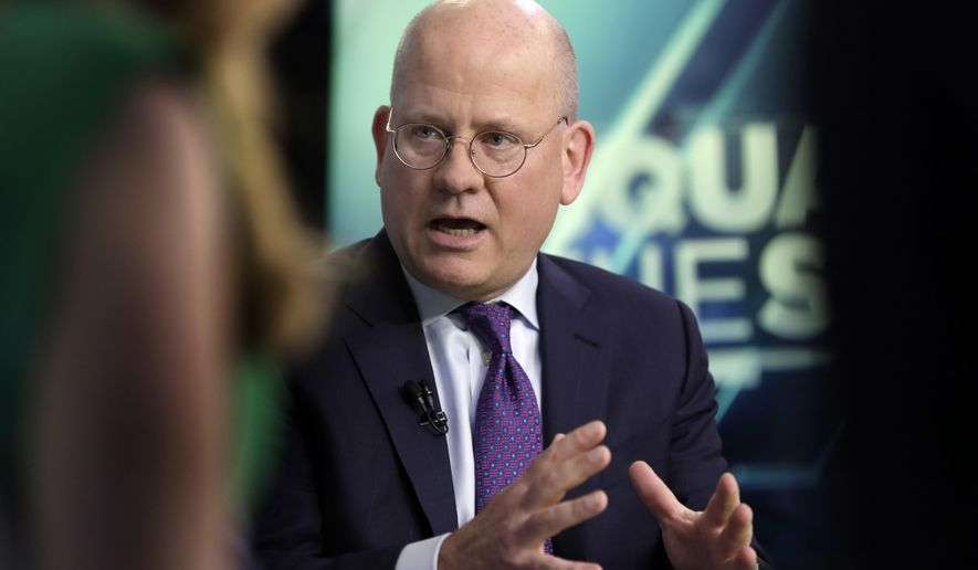FILE - In this June 26, 2018, file photo, General Electric Chairman & CEO John Flannery is interviewed on the floor of the New York Stock Exchange. Flannery out as chairman and CEO at General Electric after less than two years, Lawrence Culp Jr. takes over. After less than two years and a precipitous decline in the share price at General Electric, Flannery is being ousted as chairman and CEO. (AP Photo/Richard Drew, File)