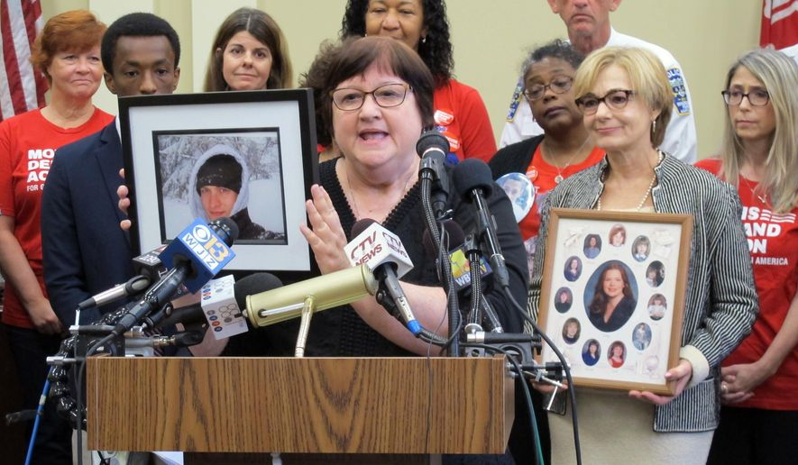 Dorothy Paugh holds a photo of her son, Peter Lapa Lilly, during a news conference in Annapolis, Maryland, on Monday, Oct. 1, 2018. Lawmakers and gun-control advocates held the news conference to discuss a new law taking effect in Maryland that enables courts to temporarily restrict firearms access for people found to be a risk to themselves or others. Paugh said the law could have helped get a gun away from her son, who shot himself in 2012. (AP Photo/Brian Witte)