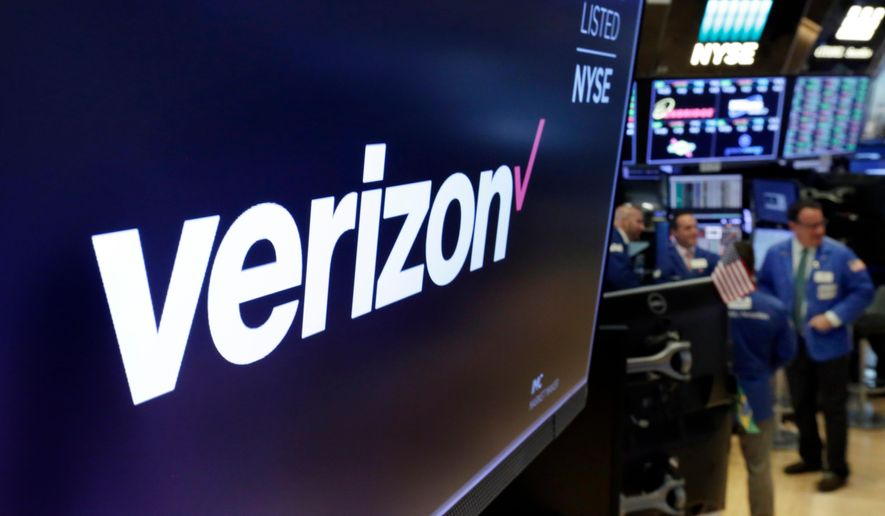 This April 23, 2018, file photo shows the logo for Verizon above a trading post on the floor of the New York Stock Exchange. Cellular companies such as Verizon are looking to challenge traditional cable companies with residential internet service that promises to be ultra-fast, affordable and wireless. Using an emerging wireless technology known as 5G, Verizon's 5G Home service provides an alternative to cable for connecting laptops, phones, TVs and other devices over Wi-Fi. It launches in four U.S. cities on Monday, Oct. 1. (AP Photo/Richard Drew, File)
