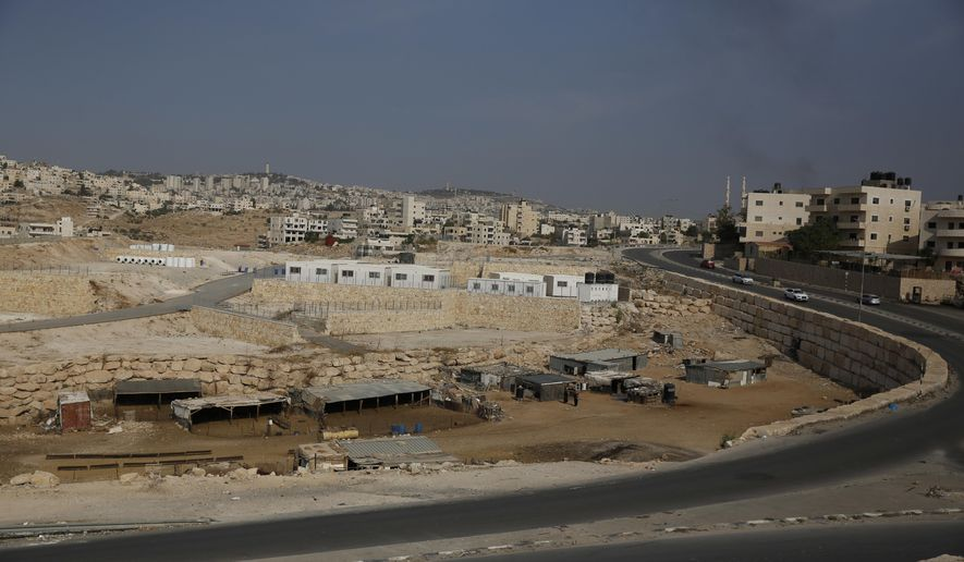 This Sunday, Sept. 30, 2018 photo shows a general view of the location where people from a Bedouin hamlet Khan al-Ahmar are supposed to move to near the West Bank village of Abu Dis. Monday marked the passing of the Israeli-imposed deadline for Khan al-Ahmar's residents to evacuate before forced removal and the demolition of their homes. (AP Photo/Majdi Mohammed)
