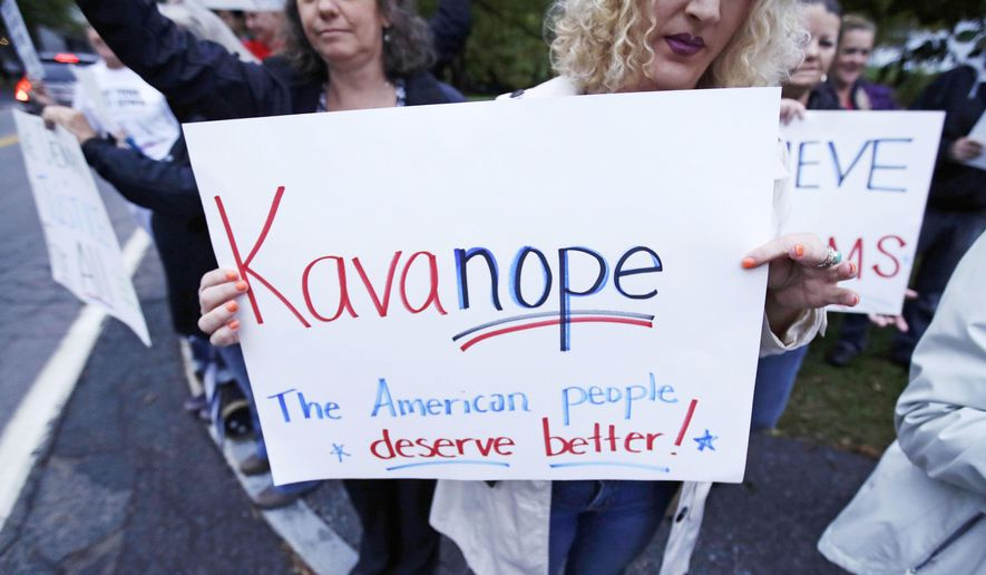 Protesters demonstrate outside a political event hosting U.S. Sen. Jeff Flake, R-Arizona, in Manchester, N.H., Monday, Oct. 1, 2018. Flake, days after a critical vote in support of Supreme Court nominee Brett Kavanaugh, made his second visit this year to New Hampshire. The visit will once again stoke suggestions that he might run against President Trump in 2020. (AP Photo/Charles Krupa)